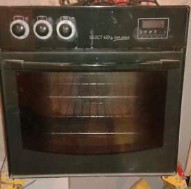 green electric fan oven and gas hob