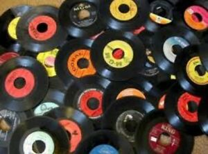 Buying old 45rpm vinyl records.