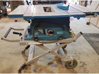 Makita Table Saw with Foldaway Wheely Stand MTL100
