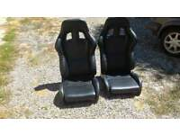Reduced...Recaro style black bucket leather seats x 2 with bracket/rail fitments
