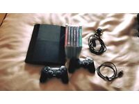 PS3 slim with 6x games and 2x controllers