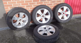 "Nearly new Kia Sportage 17"" Alloys with winter tyres (4no.)"