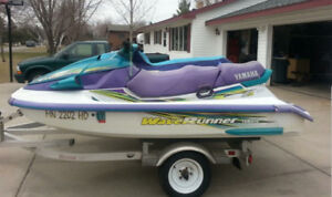 2 wave runners on double trailer
