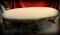 Long oval  carved  bench,  newly upholstered,  with fringe