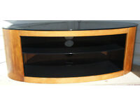 """OVAL TV STAND WITH BLACK GLASS TOP AND SHELVES AND WOOD SIDES 44""""x 18""""x 16"""" in good condition"""