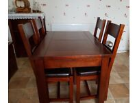 Extending Dining table and 4 chairs solid wood Ex Maitlands, great condition.