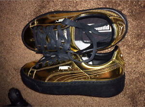 Size 7 Woman's Gold Puma's.