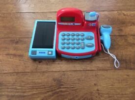 Toy cash register with toy money, microphone, scales, moving belt and scanner