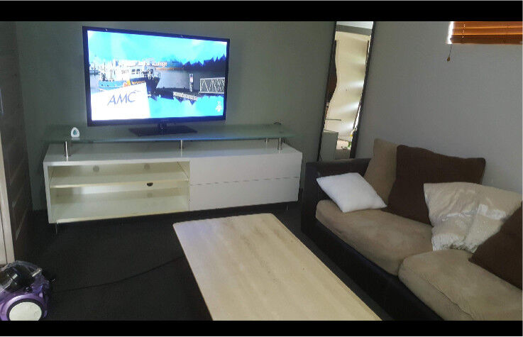 Lounge Setting Includes TV Buffet And Coffee Table