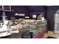 CAFE in Busy high for sale or to let, has Wine Licence and cake making equipment. Near Station