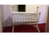 Traditional swinging, painted white crib / cot