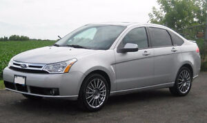 VERY  LOW KMS!!!    FORD FOCUS LIKE NEW INSIDE AND OUT