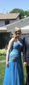 Selling size 8 beautiful blue shiny grad dress, only worn once.