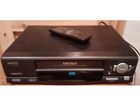 Vintage Video Cassette (VHS) Player & Remote WITH bundled with 34 videos