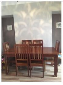 Beautiful solid oak dining table with 6 chairs
