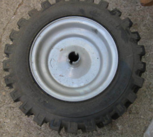 LOOKING  FOR - THIS WHEEL/ RIM - MADE FOR CRAFTSMAN SNOW BLOWER.
