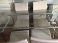 Beautiful glass and cream table and chairs 4 seats