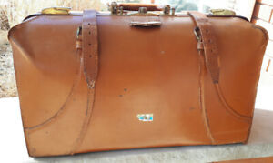 Vintage solid leather suitcase