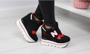 Women's black with red inserts sneakers on the platform