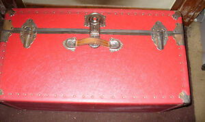 red steamer trunk from the 50's to 70'd
