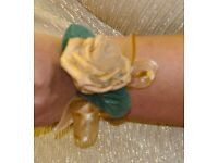 Gold wrist corsage