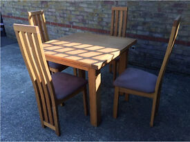 Good quality extendable solid Oak Table & chairs