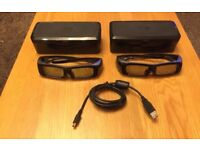 Two re- chargeable Panasonic 3D glasses