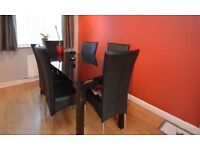 BRAND NEW black glass extending dining table and 4 chairs