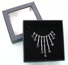 Cascade necklace on black cord measuring aprox 40cm with a 7cm extension chain GIFT BOXED - JTY357