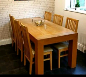 Solid wooden dinning table with 6 chairs
