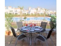 A 2 BEDROOM 2 BATHROOM HOLIDAY RENTAL OVERLOOKING GARDENS AND A 33 METRE POOL IN SUNNY MURCIA SPAIN