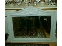 Cream over mantle mirror