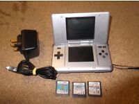 original nintendo ds with games and charger