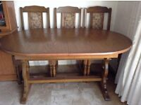 Oak Dinning table and four chairs with tapestry seats and backs