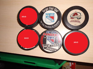 NHL hockey pucks and figures $2 each