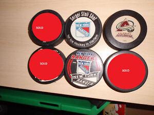 NHL hockey pucks and figures $2 each