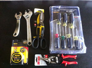 crescent wrench/screw driver/snipes /tape measure/sheet metal