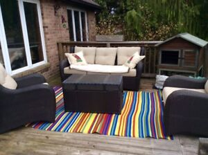 Patio Furniture Set - 4 Pieces with cushions.