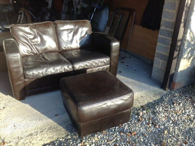 Leather two-seater sofa & matching footstool