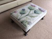 Reupholstered vintage footstool.