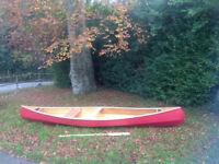 Wooden Canadian Canoe and wooden paddle