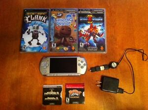 PSP with 3 games and 2 movies
