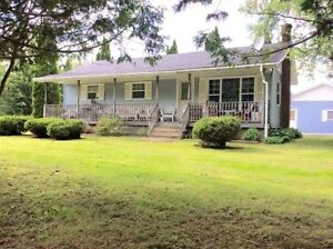 2 Bed 1 Bath home with large lot and Huge Garage!