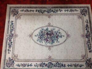 Carpette beige à fleurs dimensions de 5''7