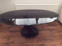 Black glass oval coffee table with spiral piano key stand