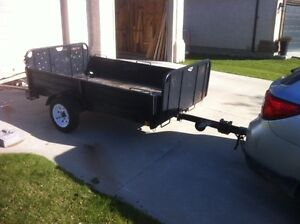 Utility trailer (4' by 8' box) with two spare tires on rims.