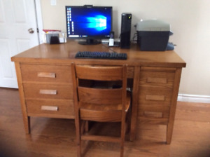 Solid oak Teacher desk and chair in excellent condition.  56Lx34