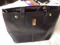 Black Bag with two separate zipped pockets. NEW from Egypt.