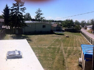 5 bed 4 bath and Basement Suite & Garage on 1/3 Acre in Airdrie!