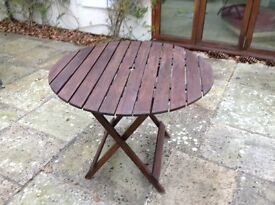 REDUCED FOR QUICK SALE! Folding wooden garden table.Good condition.3 foot diameter. Easy to store